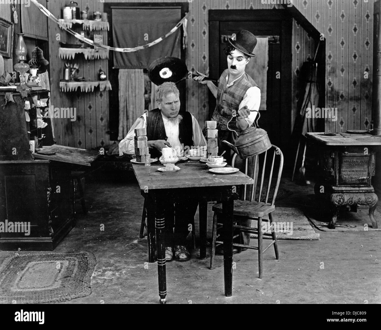 Charlie Chaplin and Tom Wilson on-set of the Film, Sunnyside, 1919 - Stock Image