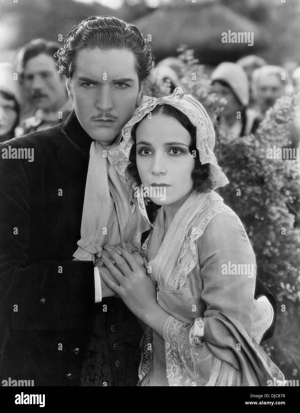 Roland Drew and Delores Del Rio on-set of the Film, Evangeline, 1929 - Stock Image