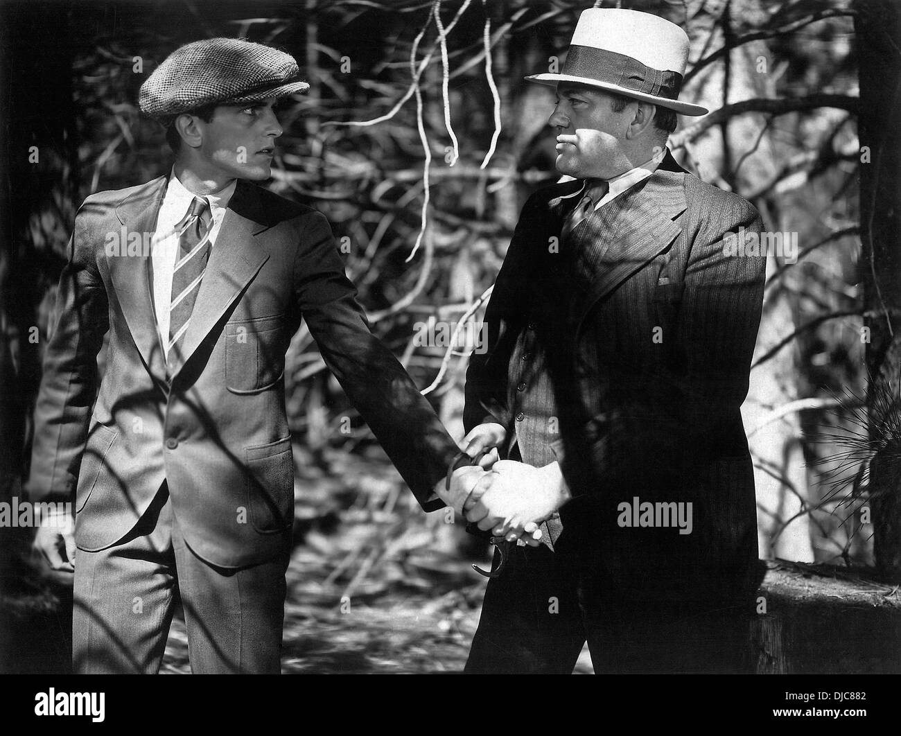 Phillips Holmes and Richard Cramer on-set of the Film, An American Tragedy, 1931 - Stock Image