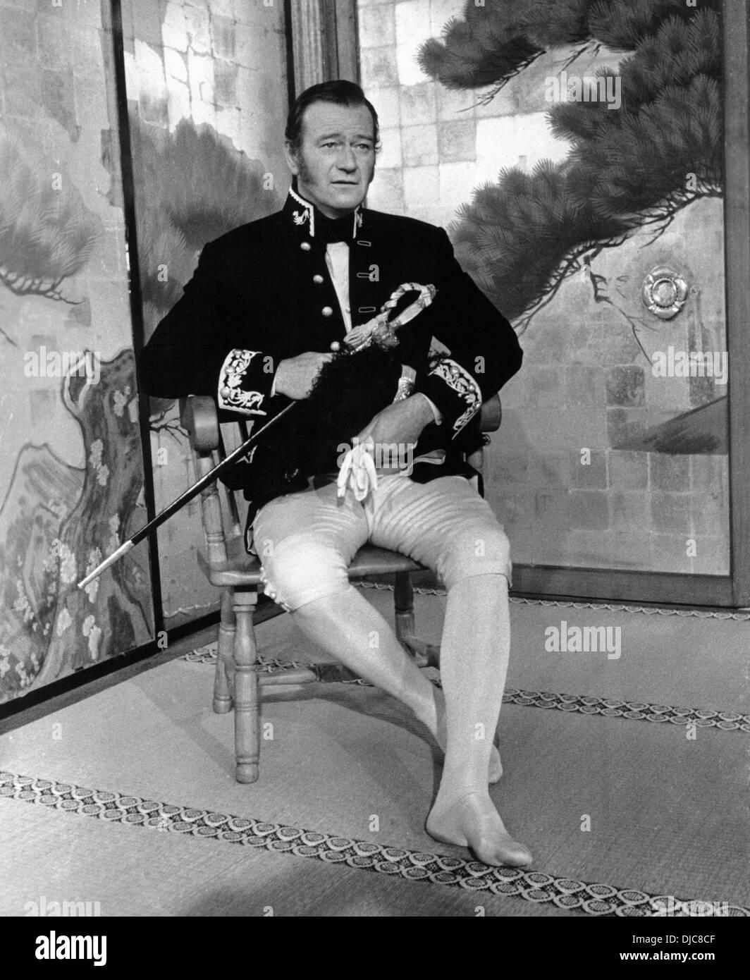 John Wayne on-set of the Film, The Barbarian and the Geisha, 1958, TM & Copyright (c) 20th Century Fox Film Corp. - Stock Image