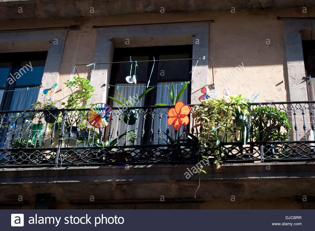 Balcony with flower, Ribera district, Barcelona, Spain - Stock Image