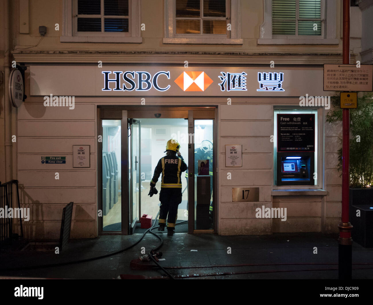 The Fire Service attend a smoke filled HSBC Bank Gerrard Street London UK 26th November 2013. The road was taped off at around 7.15pm as crowds watched the fire crews investigate and deal with the cause of the smoke. Credit Julian Eales/Alamy Live News - Stock Image