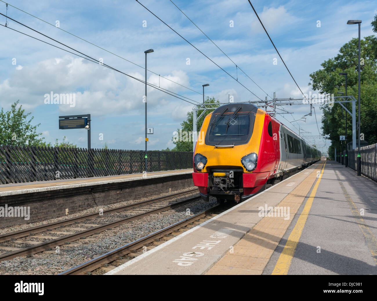 A high speed train passing through a station, England - Stock Image