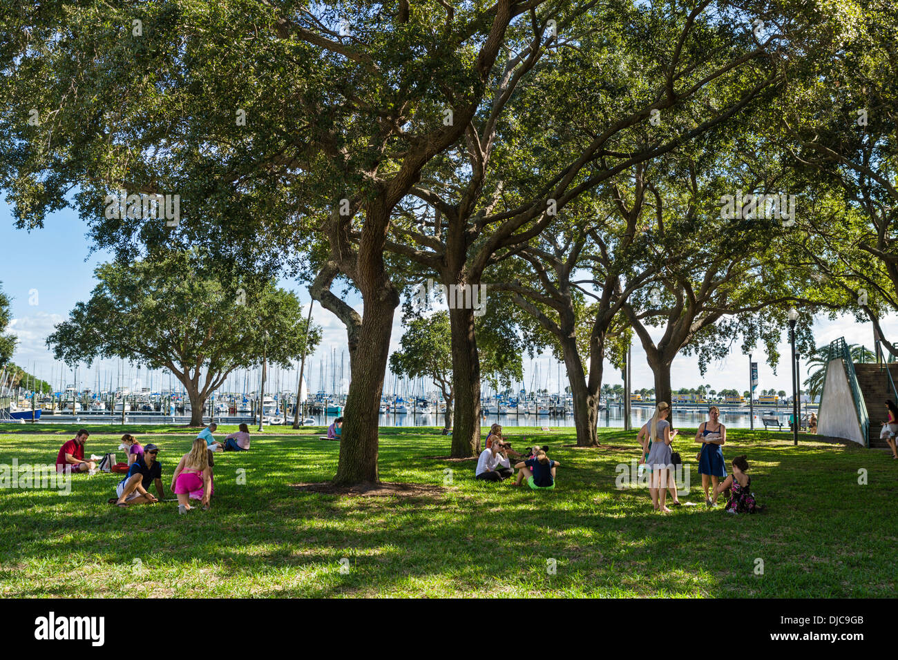 People picnicking on the grass at Progress Energy Park in downtown St Petersburg, Florida, USA - Stock Image