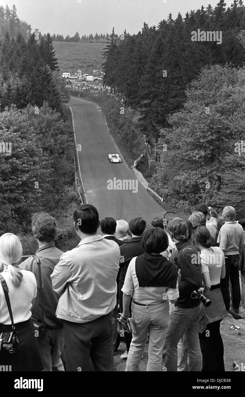 Spectators enjoy the scene at Brunnchen at the Nurburgring 1000Kms race, Germany 31 May 1970. - Stock Image