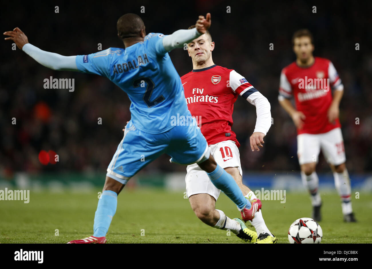 London, UK. 26th Nov, 2013. ( Jack Wilshere (R) of Arsenal vies with Kassim Abdallah of Marseille during the UEFA Champions League Group F match at Emirates Stadium in London, Britain on Nov. 26, 2013. Arsenal won 2-0 Credit:  Xinhua/Alamy Live News - Stock Image