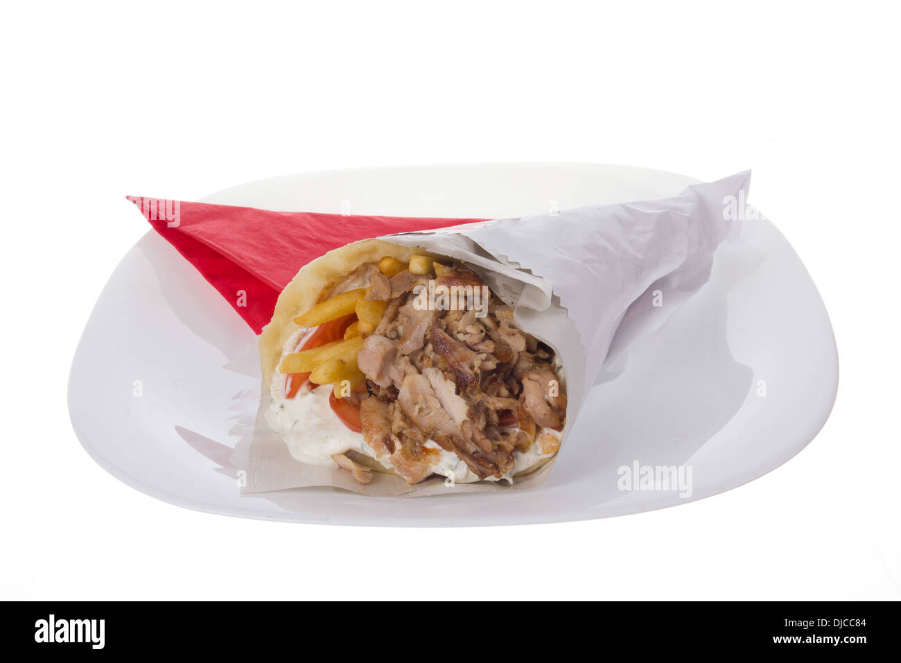 giro with pork and french fries on white plate - Stock Image