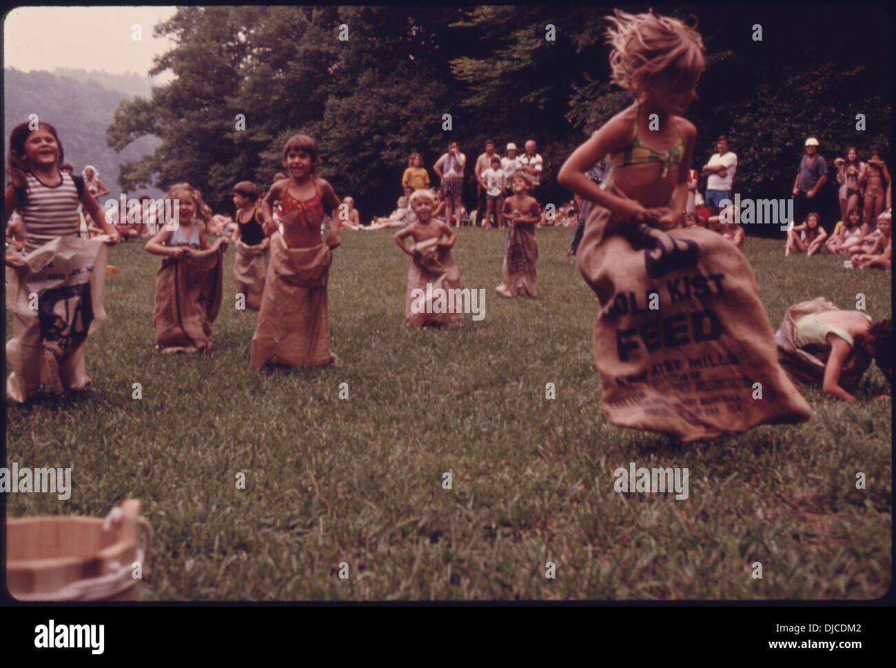 YOUTHFUL CONTESTANT LEADS A SACK RACE TOWARDS THE FINISH LINE DURING AN OLD FASHIONED GAMES CONTEST HELD AT UNICOI . 774 - Stock Image