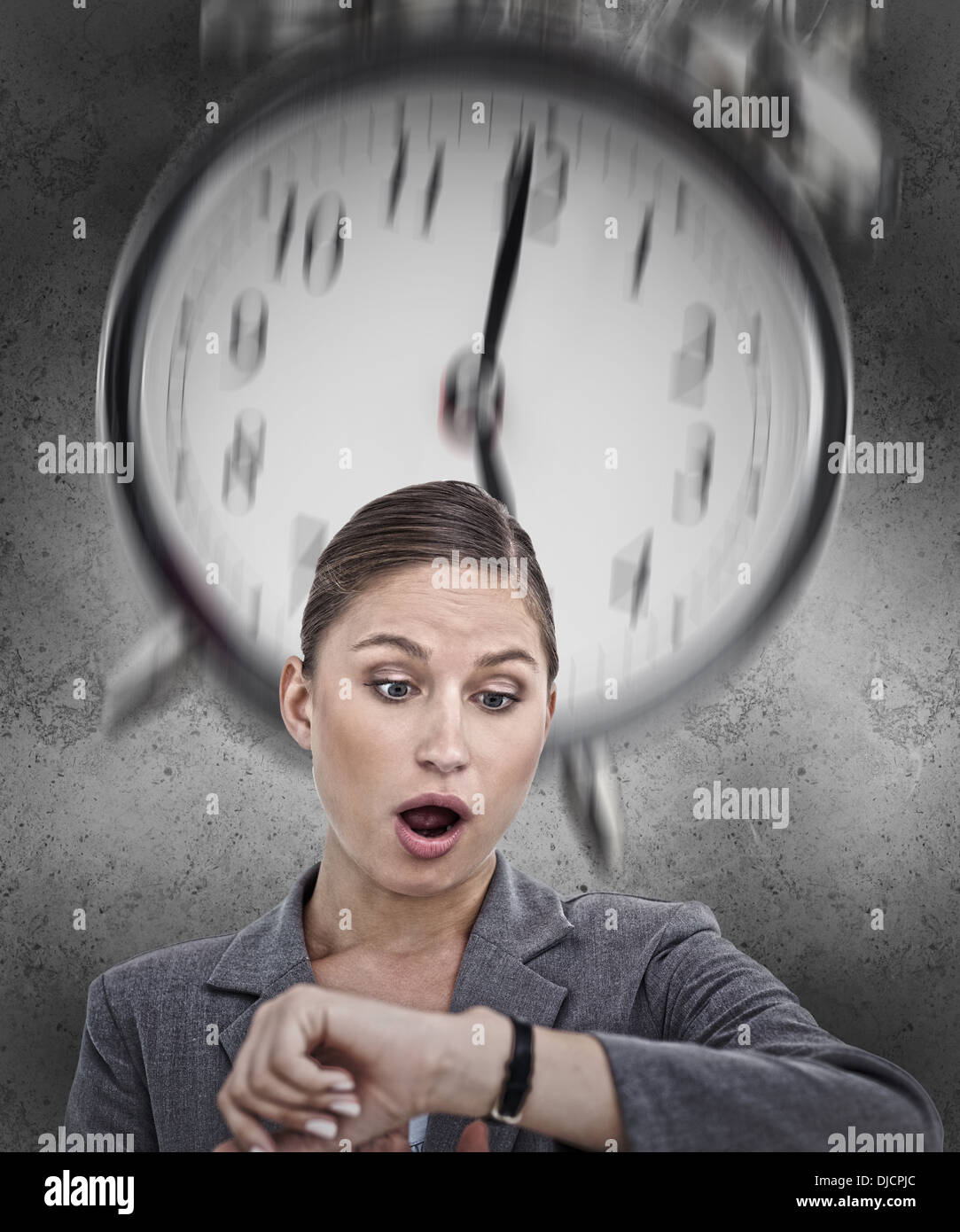 Businesswoman realising she is running out of time - Stock Image