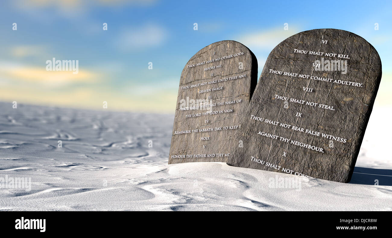 Two Stone Tablets With The Ten Commandments Inscribed On Them Standing In  Brown Desert Sand Infront