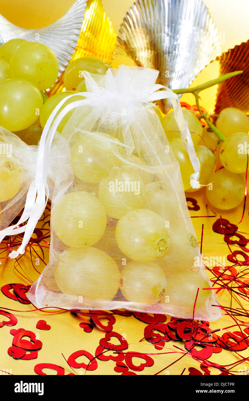 sachet with the spanish twelve grapes of luck, traditional on the New Year in Spain - Stock Image