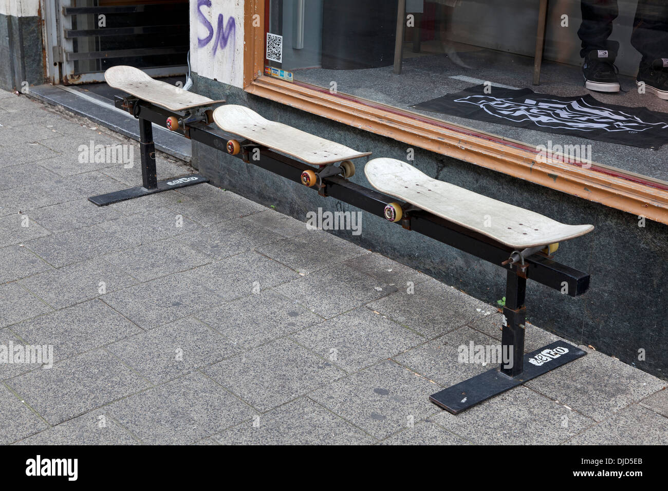 Bench made out of skateboards for a shop in Amsterdam - Stock Image