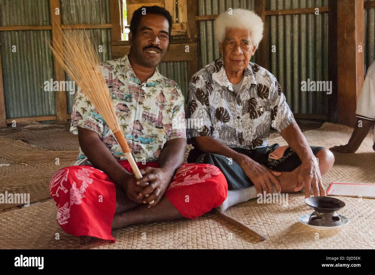 Sevusevu ceremony. Chief Taniela Bese and the Chief's spokesman (with fan) Meli Yasa.  Muanaicake, Fulaga, Fiji - Stock Image