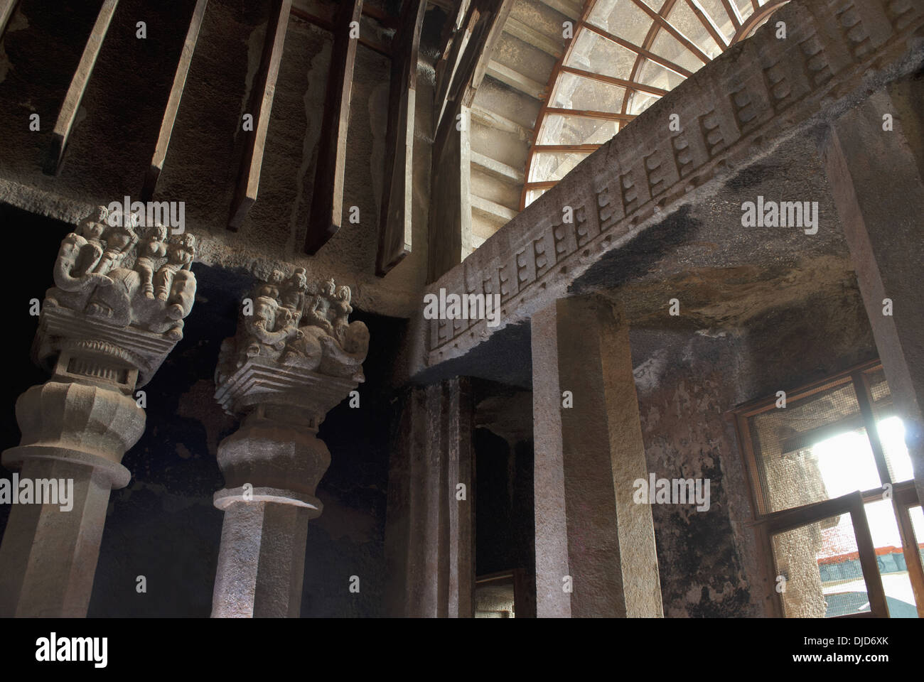 Chaitya hall showing right side pillars and wooden appendages on the upper portion. Karla Caves, dist Pune, Maharashtra India. - Stock Image