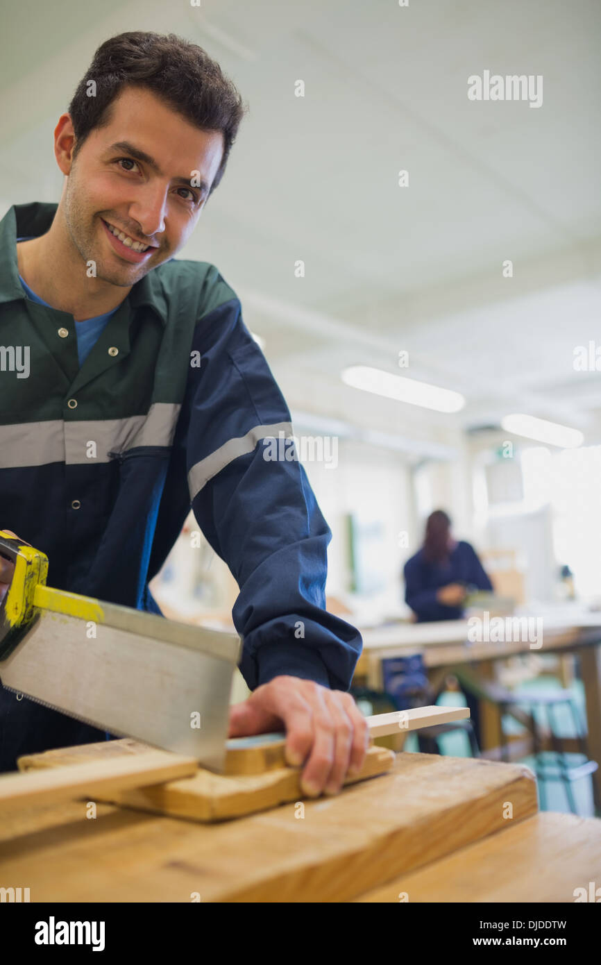 Carpentry Carpenter Woodworker Woodworking Wooden: Woman Sawing Wood Stock Photos & Woman Sawing Wood Stock