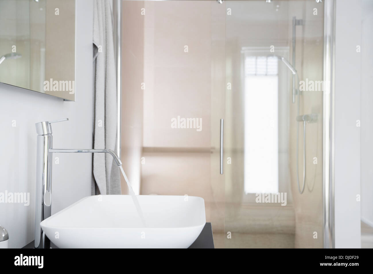 Germany, Cologne, Bathroom sink with running water - Stock Image