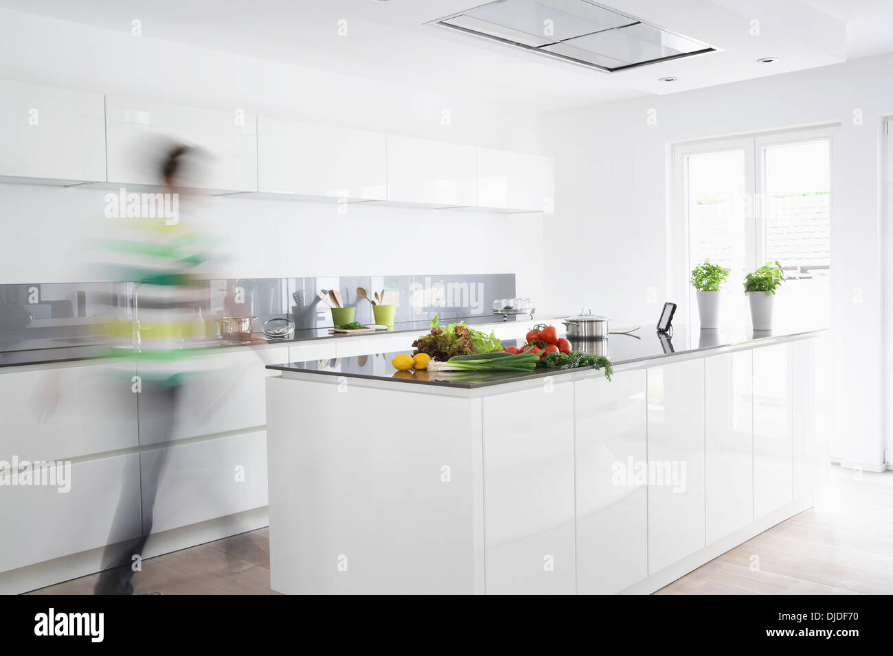 Germany, Cologne, Man in kitchen, blurred motion Stock Photo ...