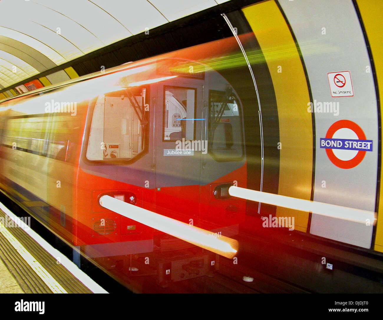 Subway on the Jubilee Line in London England pulling into the Bond Street tube station - Stock Image
