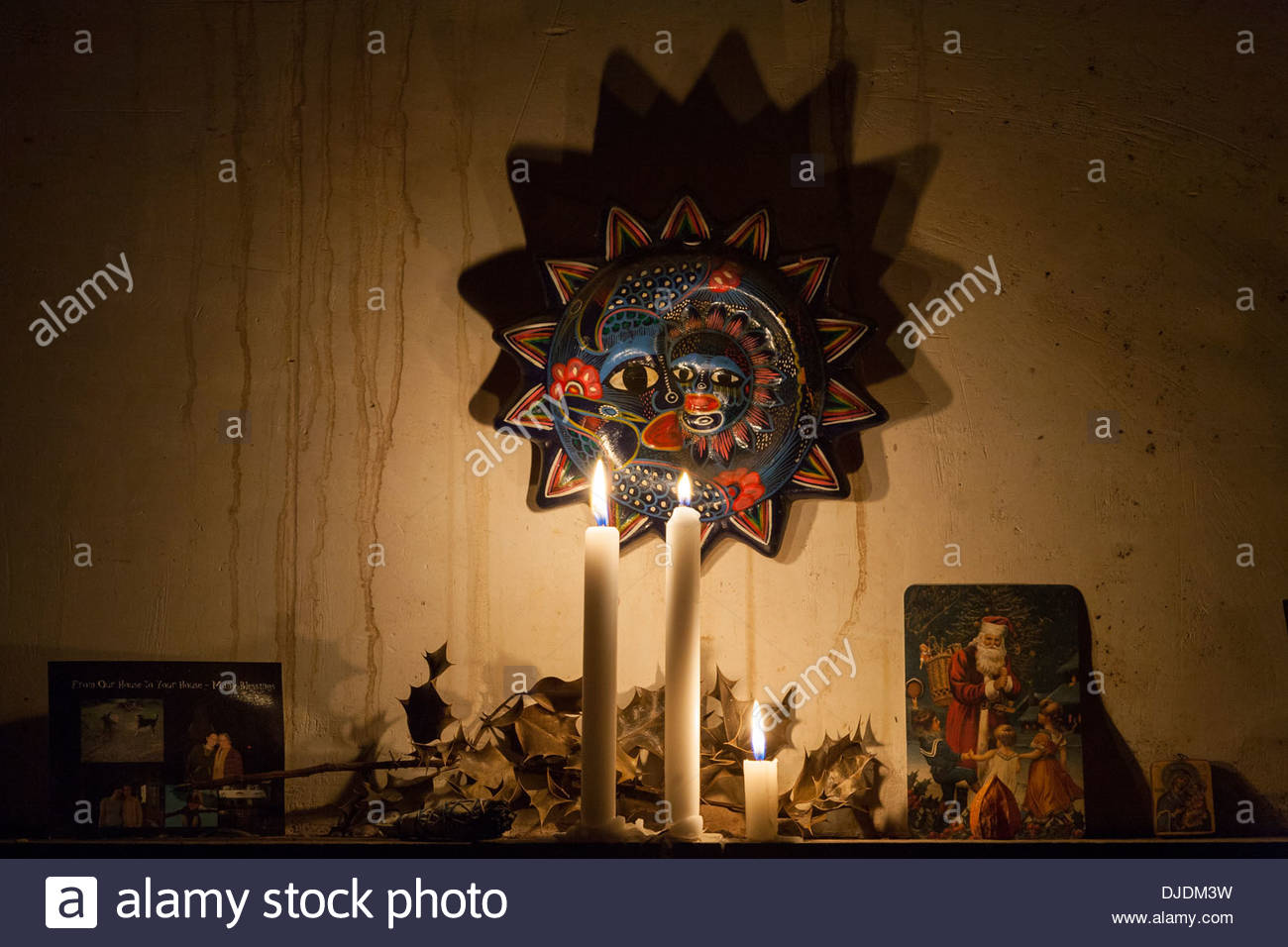 Lit candles on a mantle in an old French farmhouse - Stock Image
