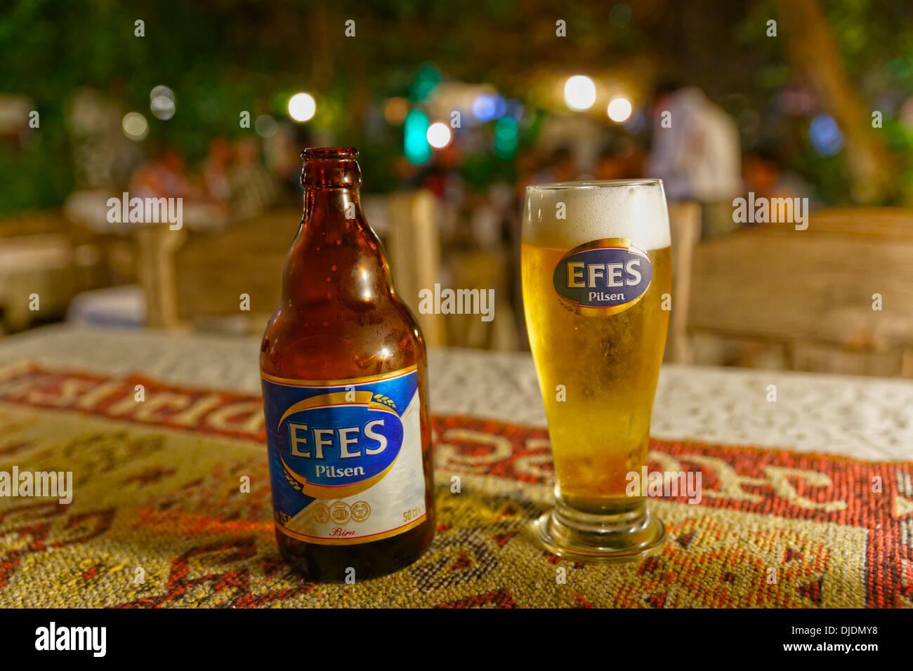 Efes Pilsen beer bottle and beer glass, Dalyan, Muğla Province, Turkish Riviera or Turquoise Coast, Aegean, Turkey Stock Photo