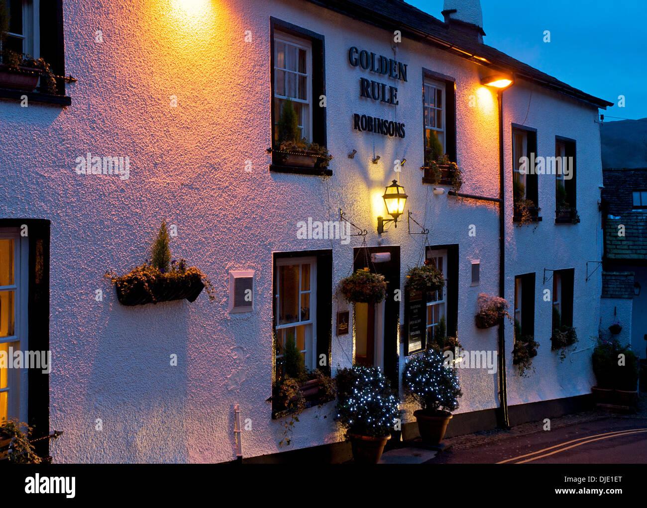 The Golden Rule pub, at dusk, Ambleside, Lake District National Park, Cumbria, England UK - Stock Image