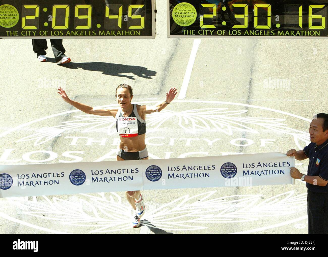 Mar 07, 2004; Los Angeles, CA, USA; TATYANA POZDNYAKOVA from Ukraine races to the finish line first in the women's divison of the Los Angeles Marathon XIX in Los Angeles, CA. - Stock Image