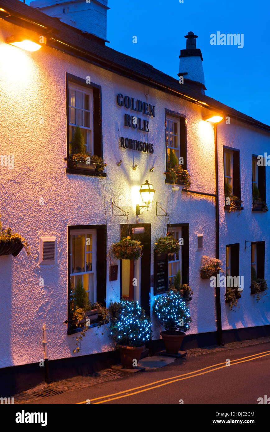 The Golden Rule pub, at dusk, Ambleside, Lake District National Park, Cumbria, England UK - Stock Image