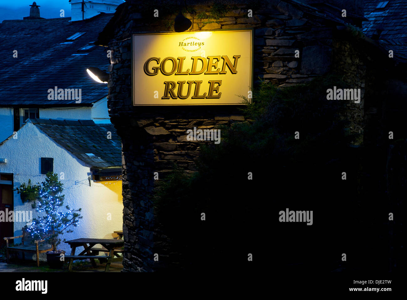 Illuminated sign for pub, the Golden Rule, in Ambleside, Lake District National Park, Cumbria, England UK - Stock Image