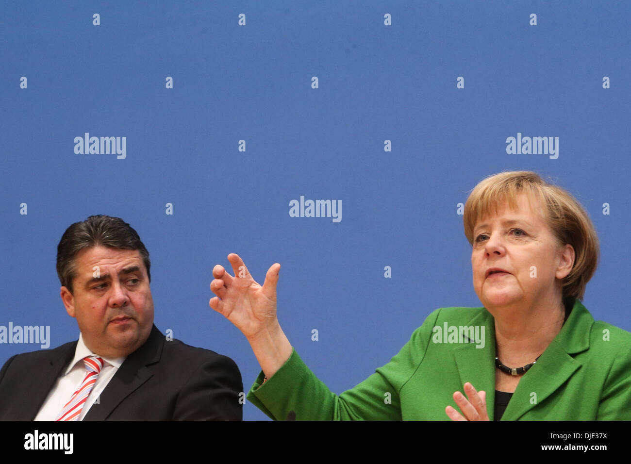 Berlin, Germany. 27th Nov, 2013. Sigmar Gabriel (L), Chairman of the Social Democratic Party (SPD) and German Chancellor Angela Merkel attend a press conference in Berlin, Germany, on Nov. 27, 2013. Leaders from Germany's main parties signed provisionally a coalition agreement on Wednesday, paving the road for forming a new government two months after a federal election. Credit:  Zhang Fan/Xinhua/Alamy Live News Stock Photo