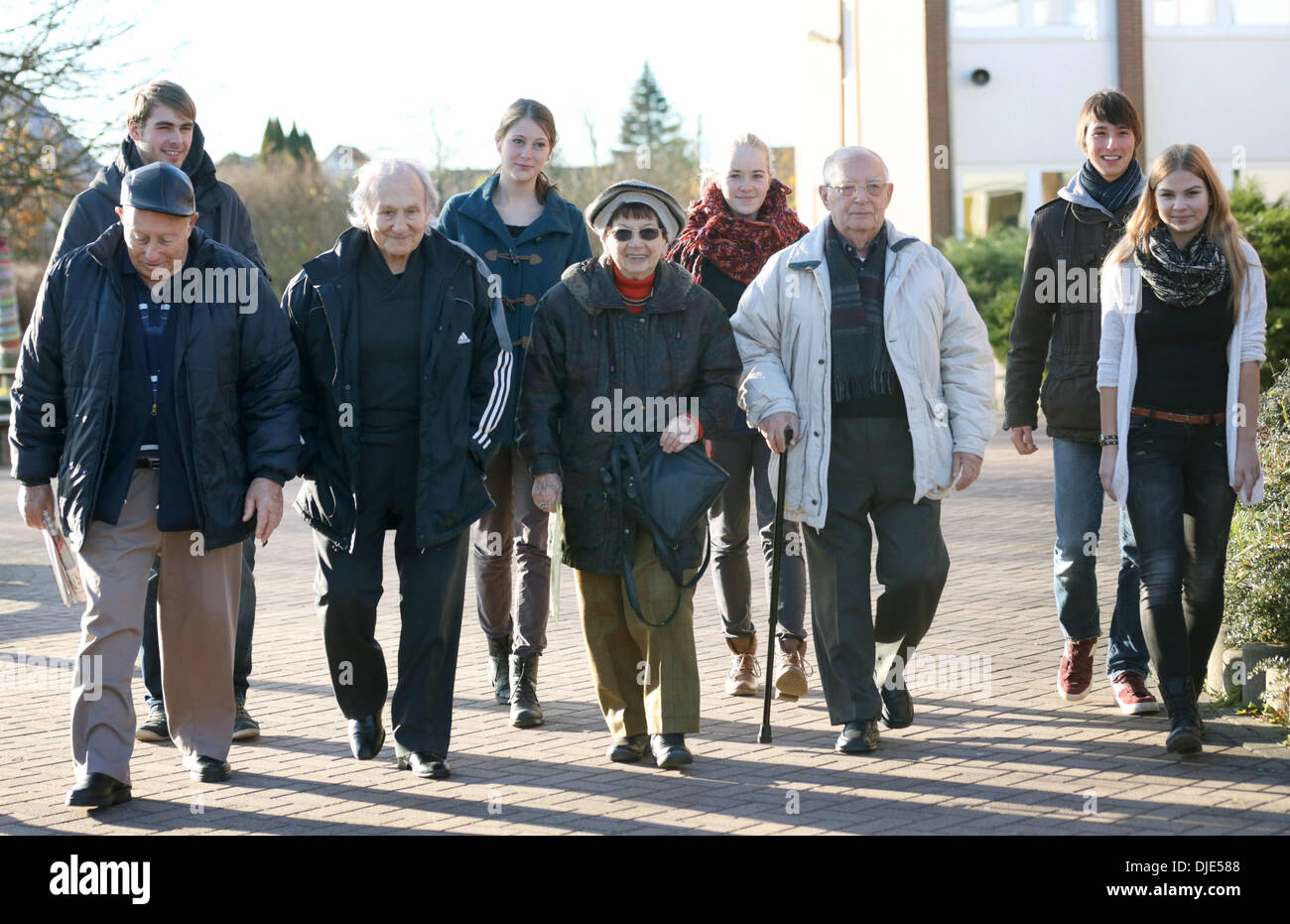 Roevershagen, Germany. 26th Nov, 2013. The four Holocaust survivors (FRONT L-R) Jacov Tsur, Noah Klieger, Batsheva Dagan and Michael Goldmann-Gilead are guests in the Heidetreff in Roevershagen, Germany, 26 November 2013. They were invited to Germany by the project group 'War graves' of the European school Roevershagen and will speak about their memories. Photo: Bernd Wuestneck/dpa/Alamy Live News - Stock Image