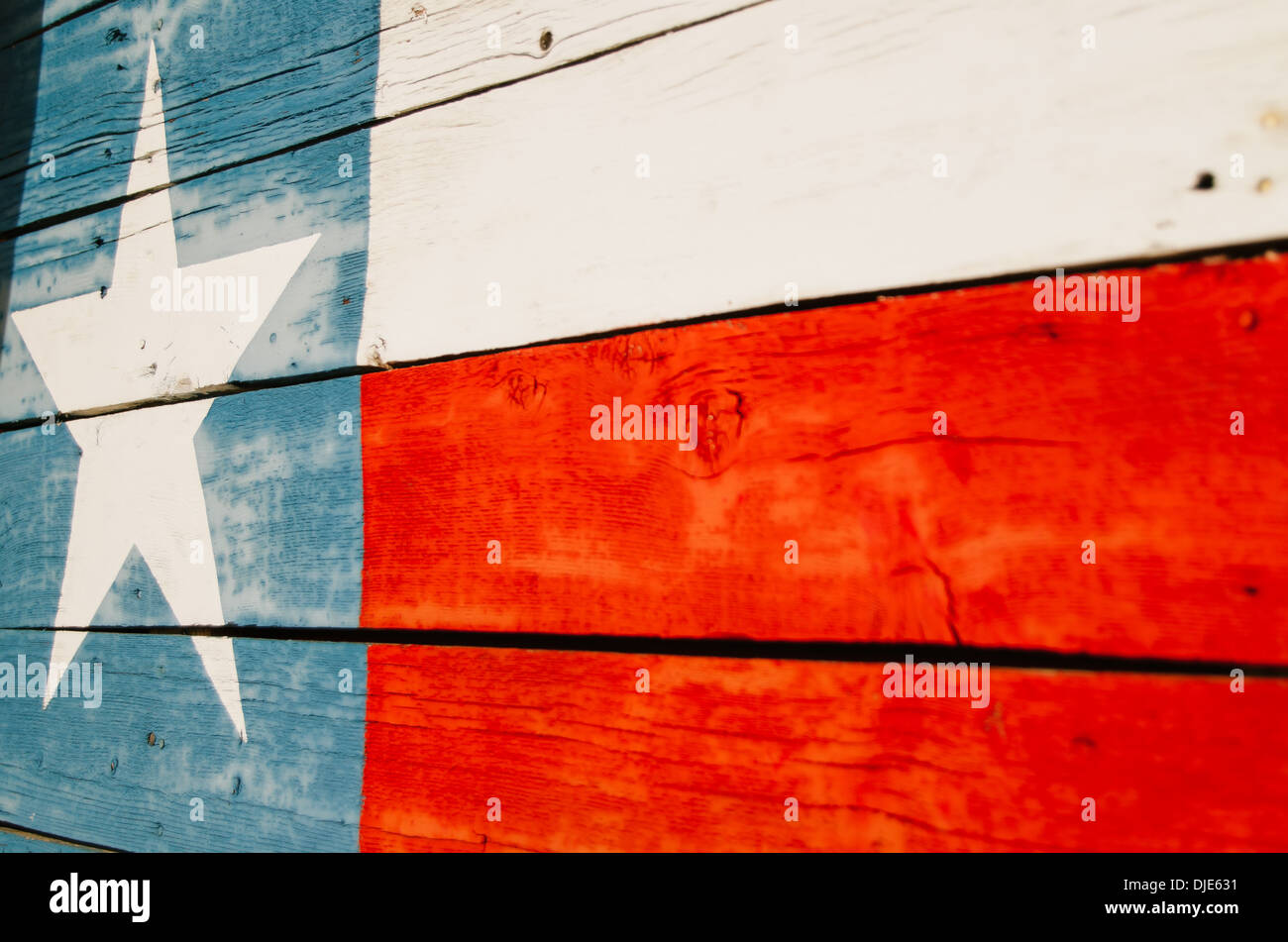 Texas flag painted over wood planks along route 281 in the hearth of Texas Hill Country. - Stock Image