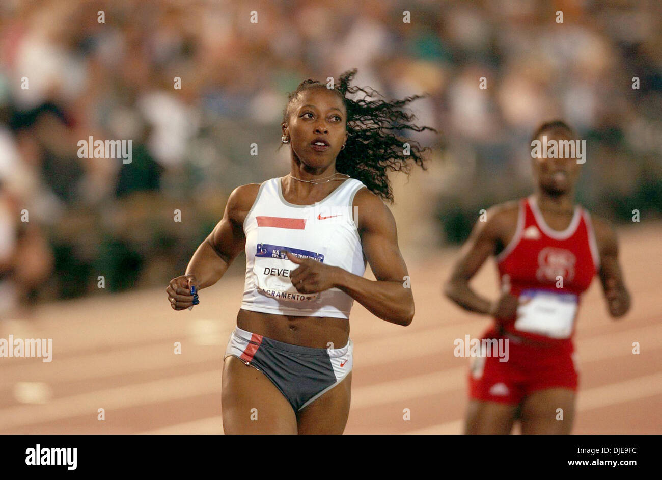 Jul 09, 2004; Sacramento, CA, USA; GAIL DEVERS crosses the finish line in the 100 meter dash and qualified fifth on day one of the 2004 U.S. Track and Field Trials at Hornet Stadium. - Stock Image