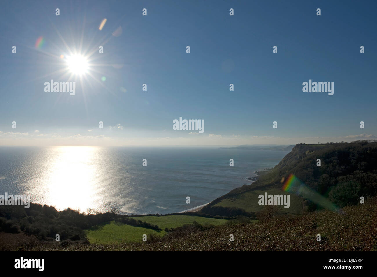 Lyme bay with a winter sun viewed from the cliffs at Weston Mouth east of Sidmouth in Devon - Stock Image