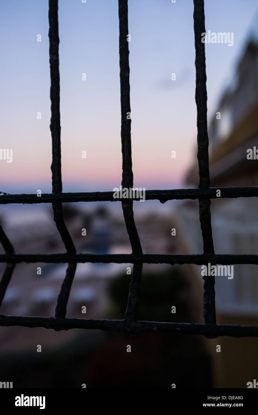 Security fence around an apartment complex in Las Salinas, Playa San Juan, tenerife canary Islands Spain - Stock Image