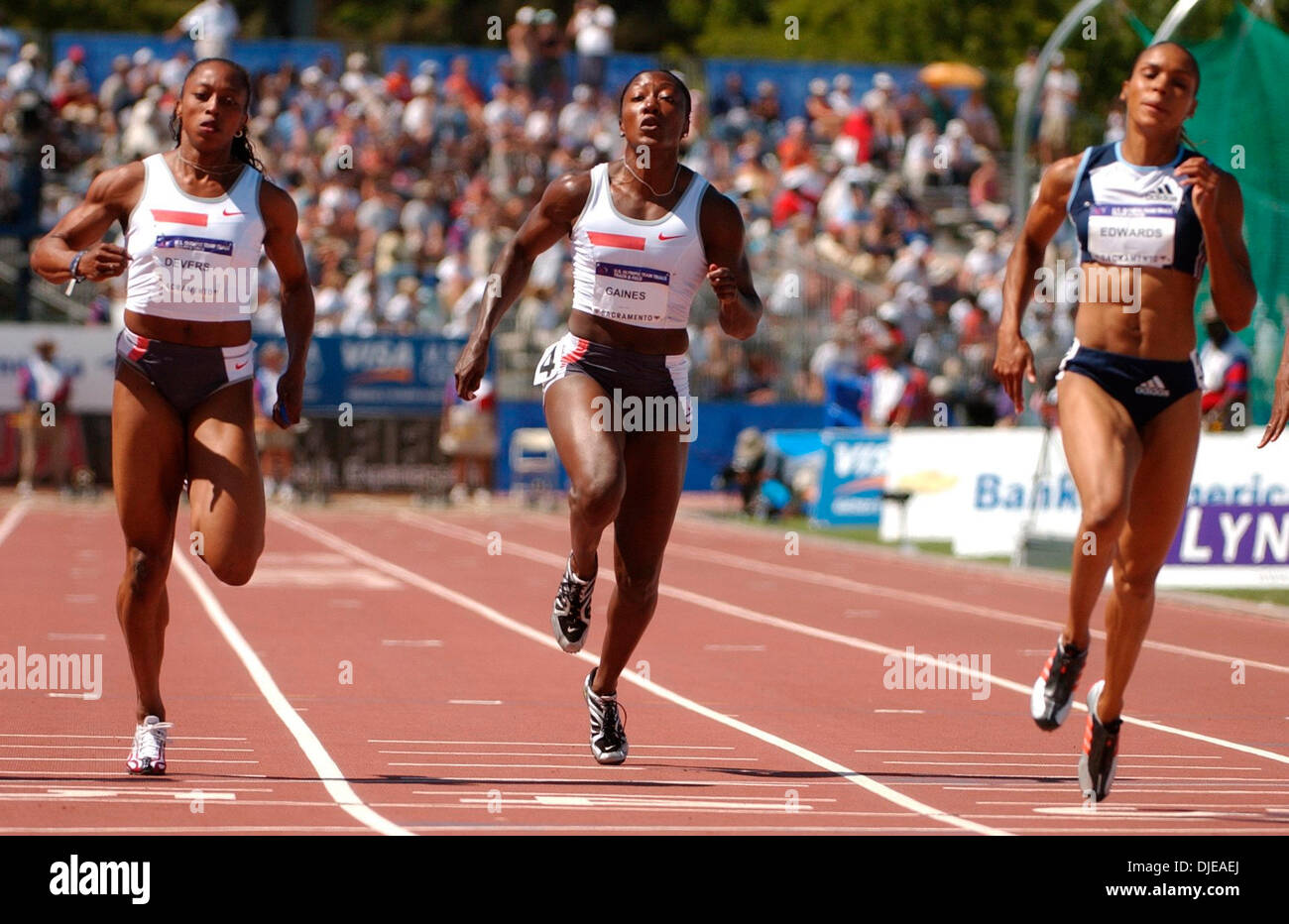 Jul 09, 2004; Sacramento, CA, USA; GAIL DEVERS, CHRYSTE GAINES and TORRI EDWARDS finsih in heat one of the Womes 100 meters on day two of the 2004 U.S. Track and Field Trials at Hornet Stadium. - Stock Image