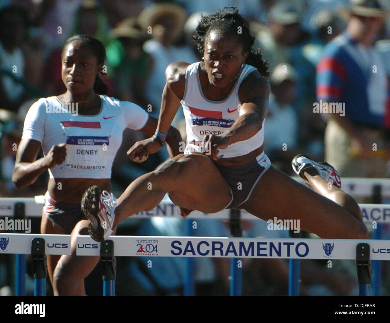 Jul 18, 2004; Sacramento, CA, USA; GAIL DEVERS clears the last hurdle to win the women's 100-meter hurdles with a time of 12.55 seconds on day eight of the 2004 U.S. Track and Field Trials at Hornet Stadium. - Stock Image