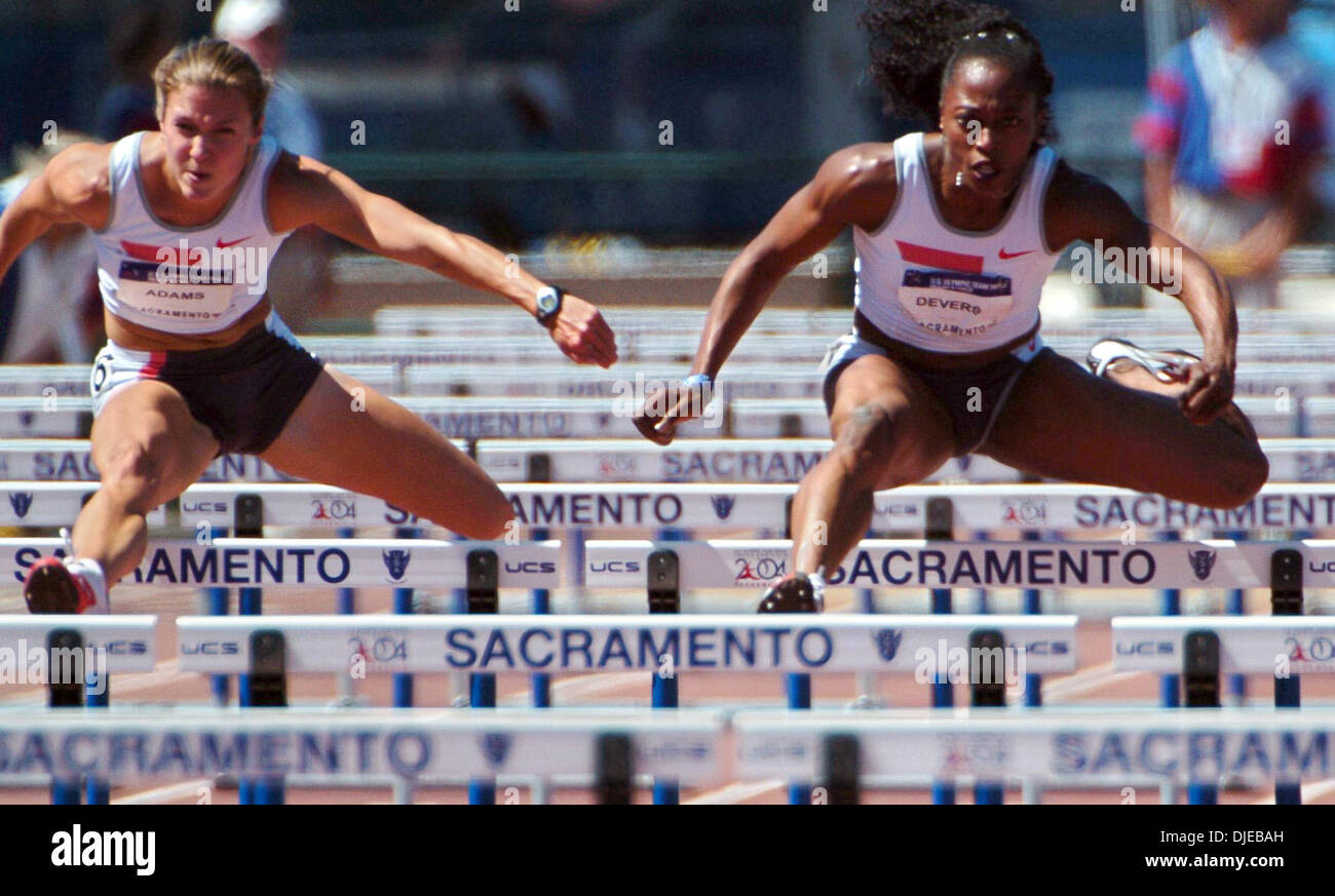 Jul 18, 2004; Sacramento, CA, USA; GAIL DEVERS (R) and JENNY ADAMS (L) clear hurdles during the women's 110-meter hurdles semifinal race on day eight of the 2004 U.S. Track and Field Trials at Hornet Stadium, Sunday, July 18, 2004. Devers was second in her heat and Adams came in third. - Stock Image