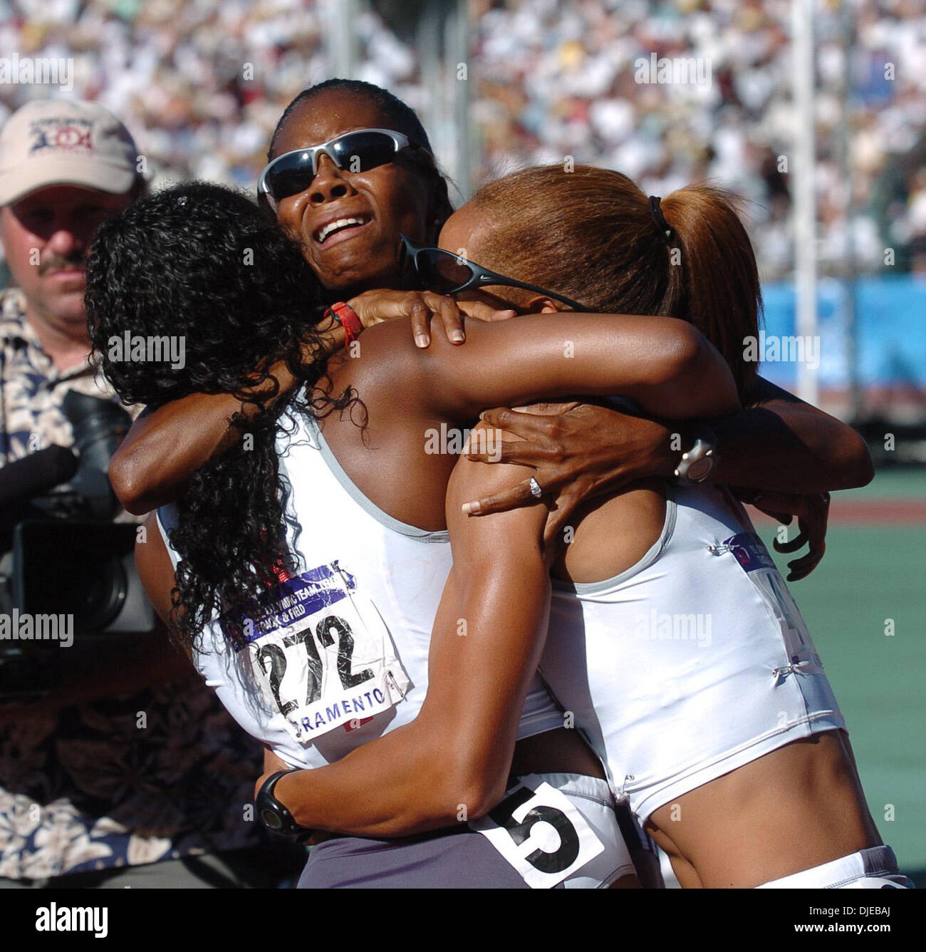 Jul 18, 2004; Sacramento, CA, USA; (L-R) GAIL DEVERS, MELISSA MORRISON and JOANNA HAYES celebrate their one, two, three placement in the women's 100-meter hurdles on day eight of the 2004 U.S. Track and Field Trials at Hornet Stadium. Devers won, Hayes was second and Morrison came in third. - Stock Image