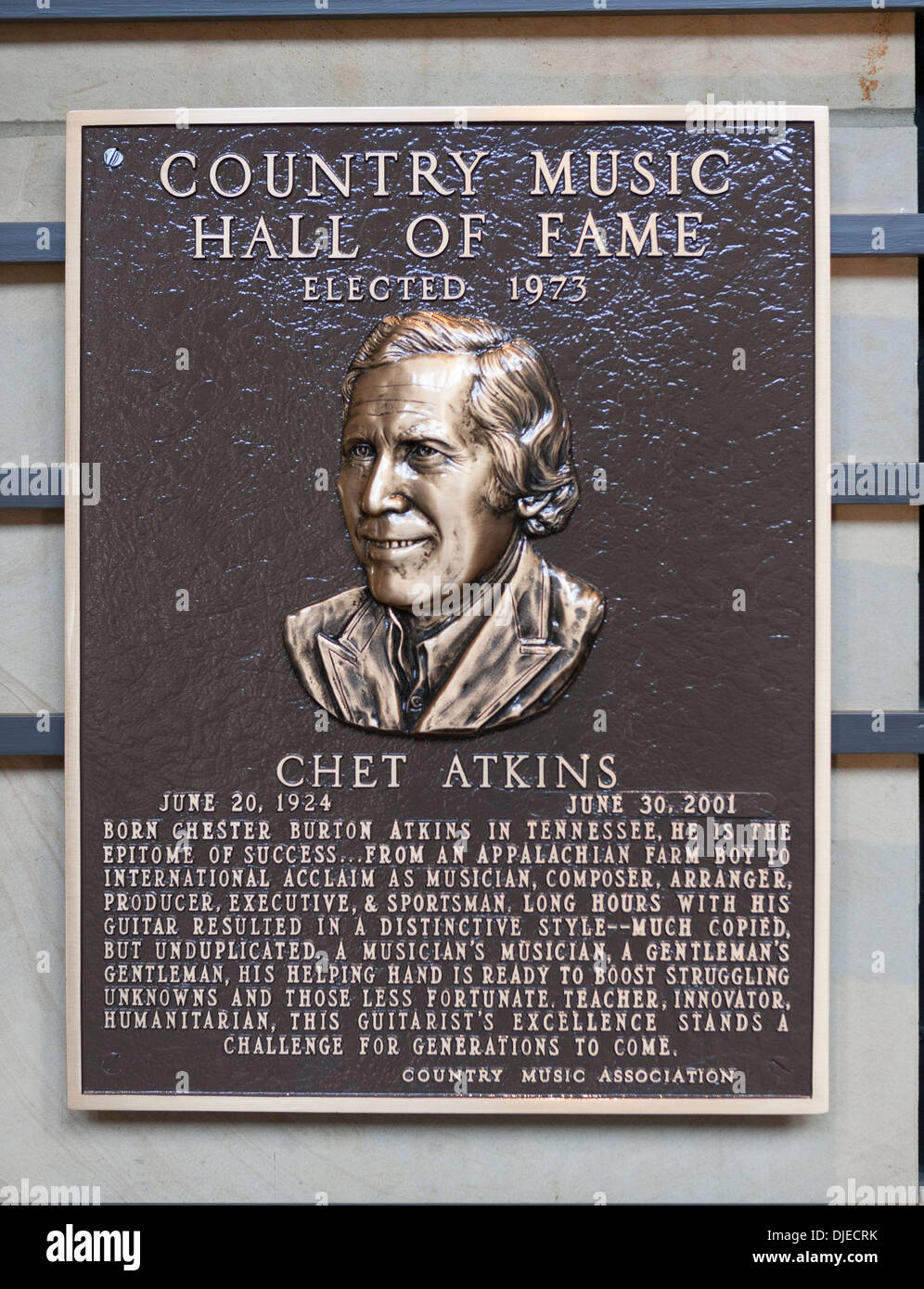 A bronze Chet Atkins Plaque inside the Country Music Hall of Fame in Nashville, TN, USA - Stock Image