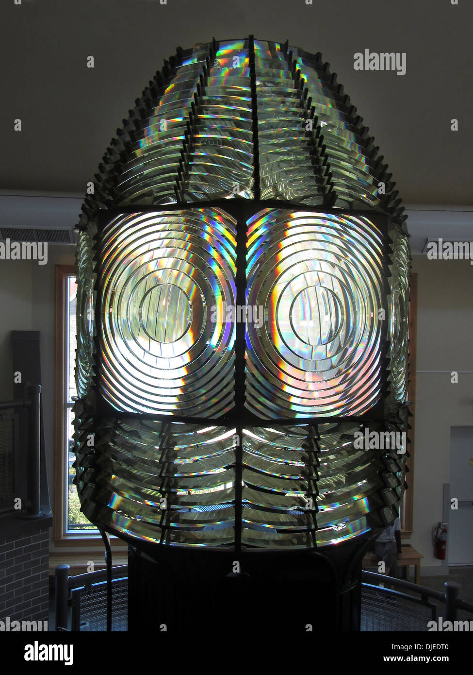 The old fresnel lens from the Fire Island Lighthouse, now housed in a museum next to the lighthouse on Fire Island - Stock Image