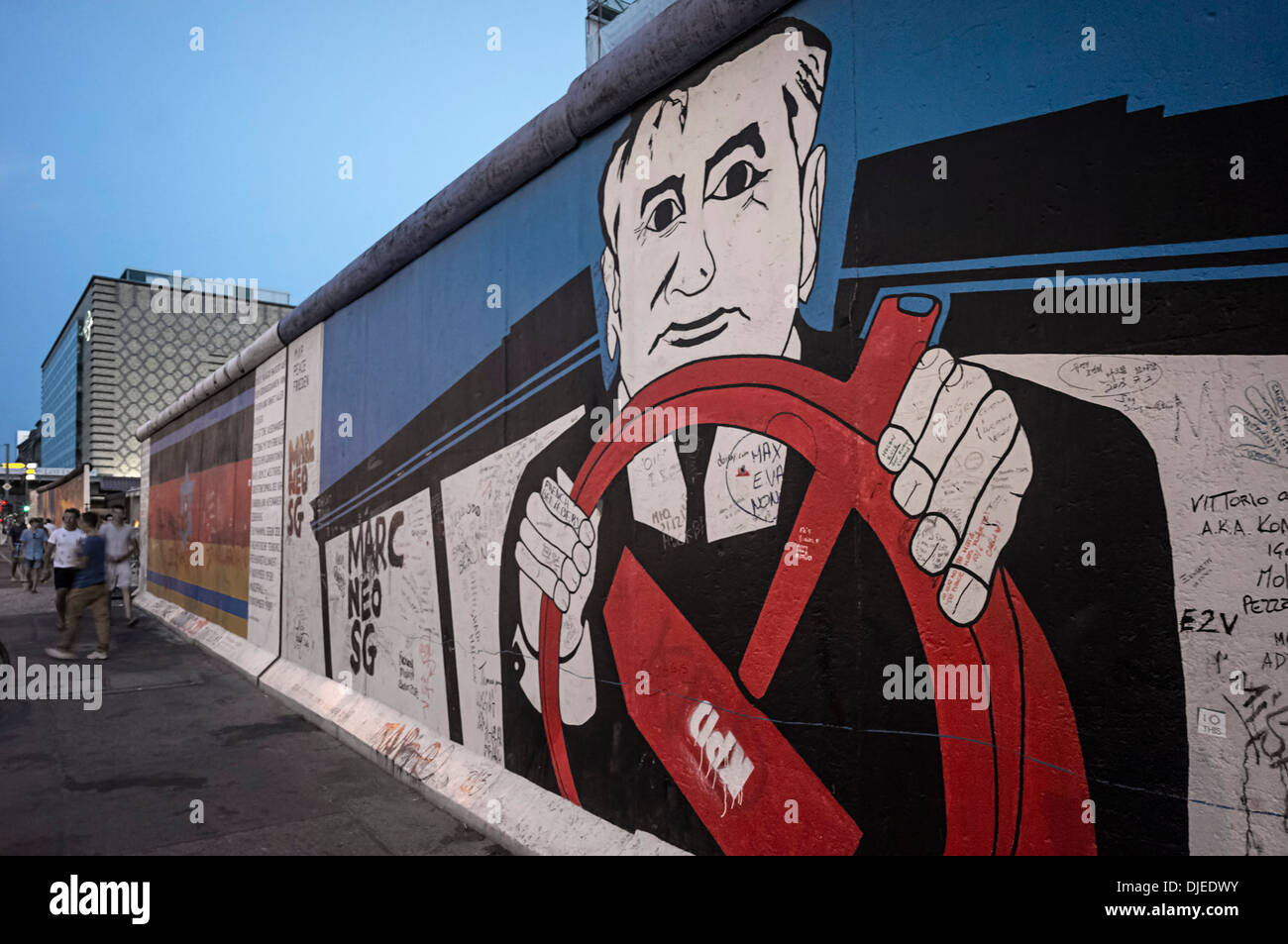 Famous graffiti of Mikhail Gorbatschow on Berlin Wall at East Side Gallery - Stock Image