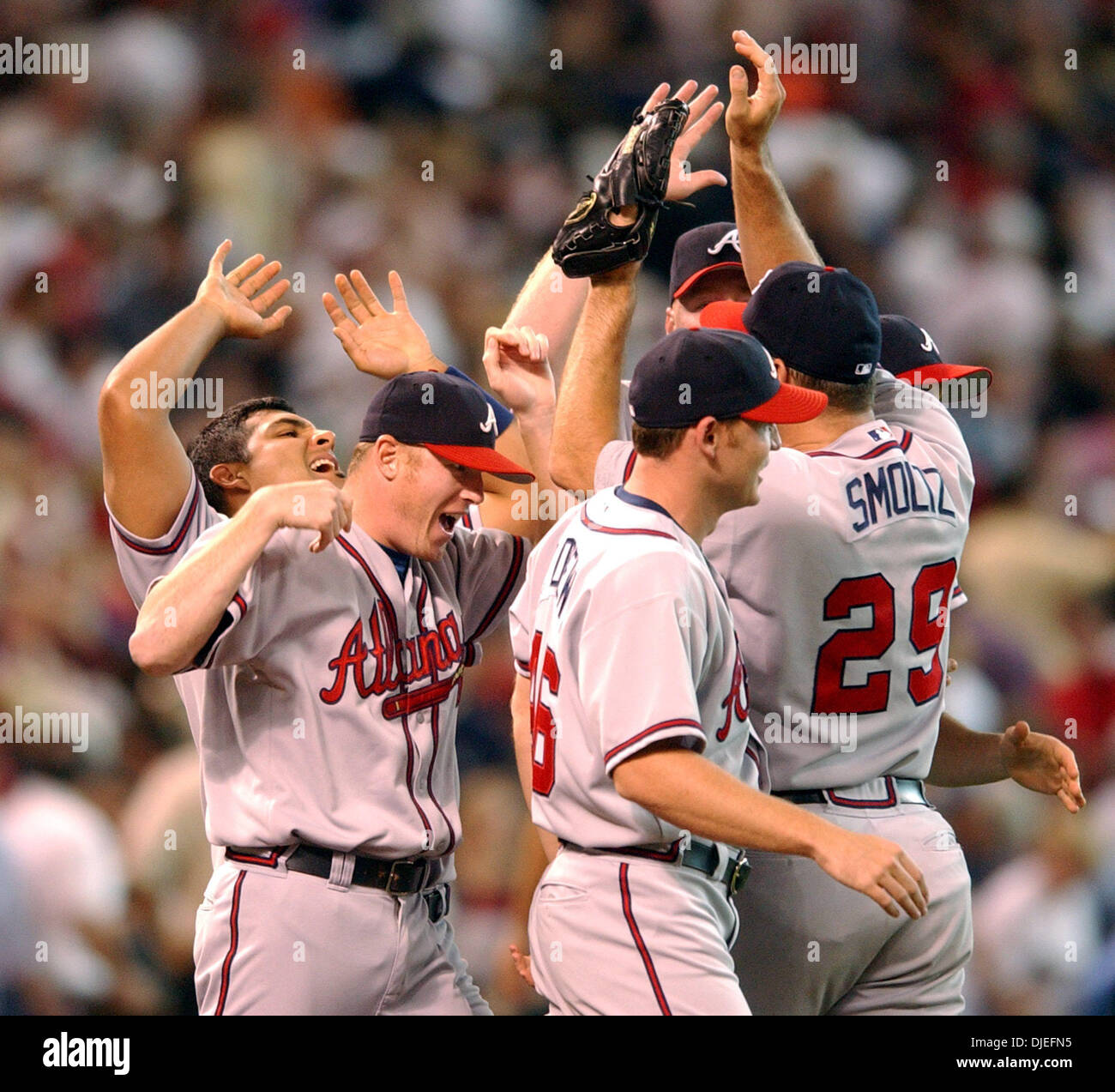 Oct 10, 2004; Houston, TX, USA; MLB Baseball: Atlanta Braves players run on the field as they celebrate their win at Minute Maid Park in Houston. The Braves tied the National League Divison Series at 2-2. - Stock Image