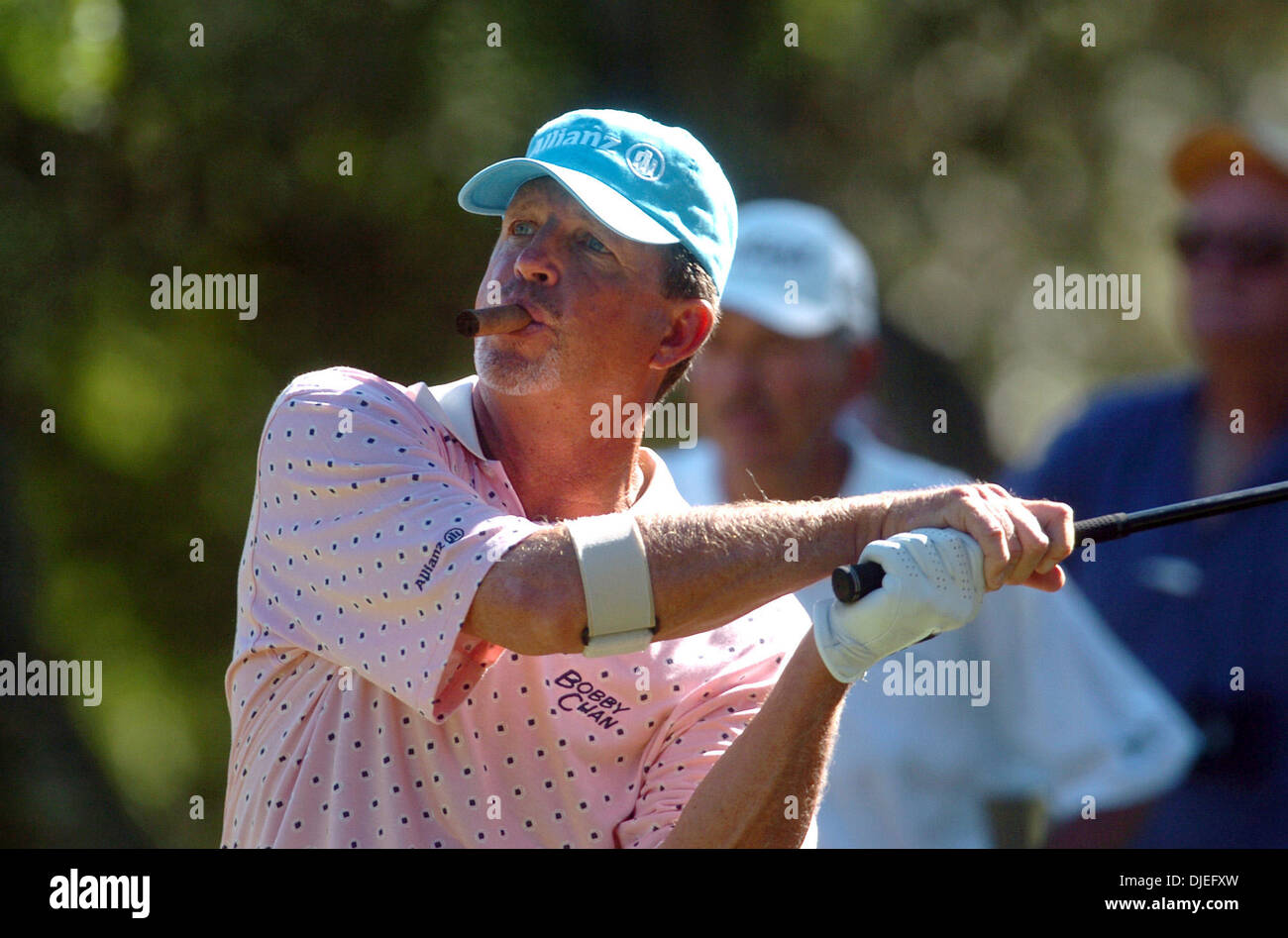 Oct 16, 2004; San Antonio, TX, USA; DANA QUIGLEY keeps his unlit cigar installed as he tees on the 17th Saturday during the second round of the SBC Championship at Oak Hills Country Club. - Stock Image