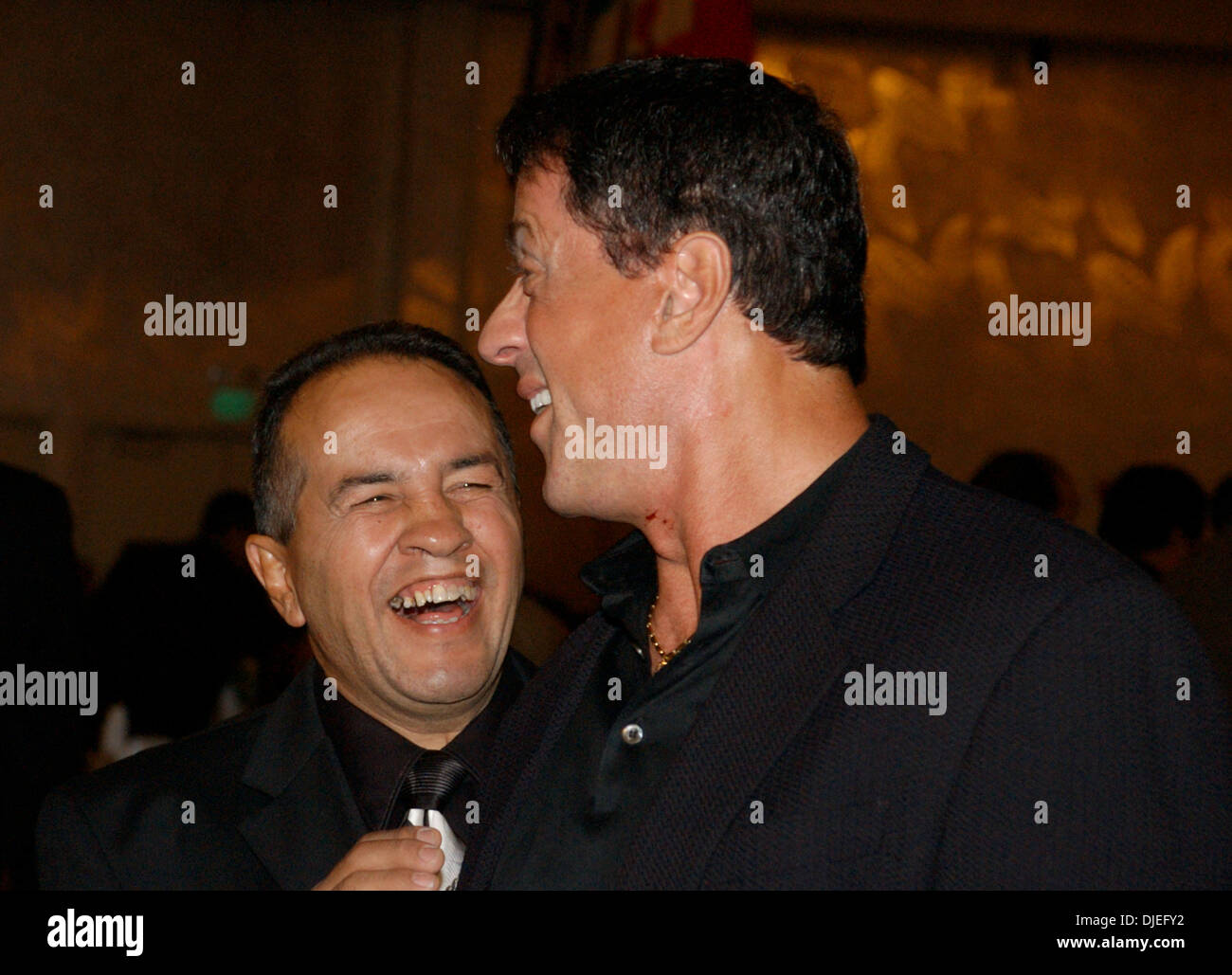 Oct 16, 2004; Commerce, CA, USA; Former Super Featherweight Champion BOBBY CHACON shares a laugh with actor SYLVESTER STALLONE at The 25th Annual World Boxing Hall of Fame Banquet held at The Commerce Casino. - Stock Image