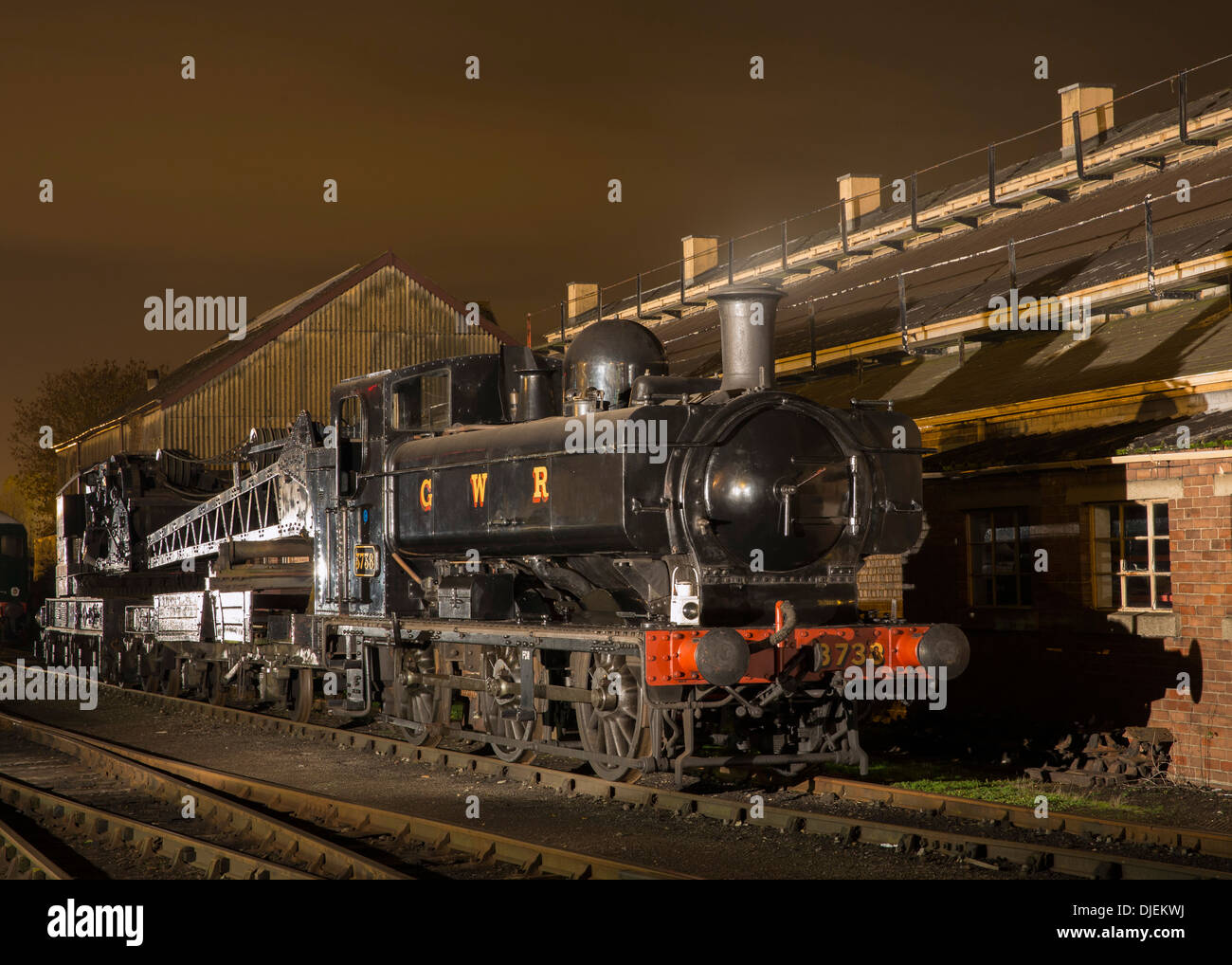 Great Western Railway (GWR) 5700 Class 0-6-0PT preserved pannier tank steam locomotive on a breakdown train at night - Stock Image