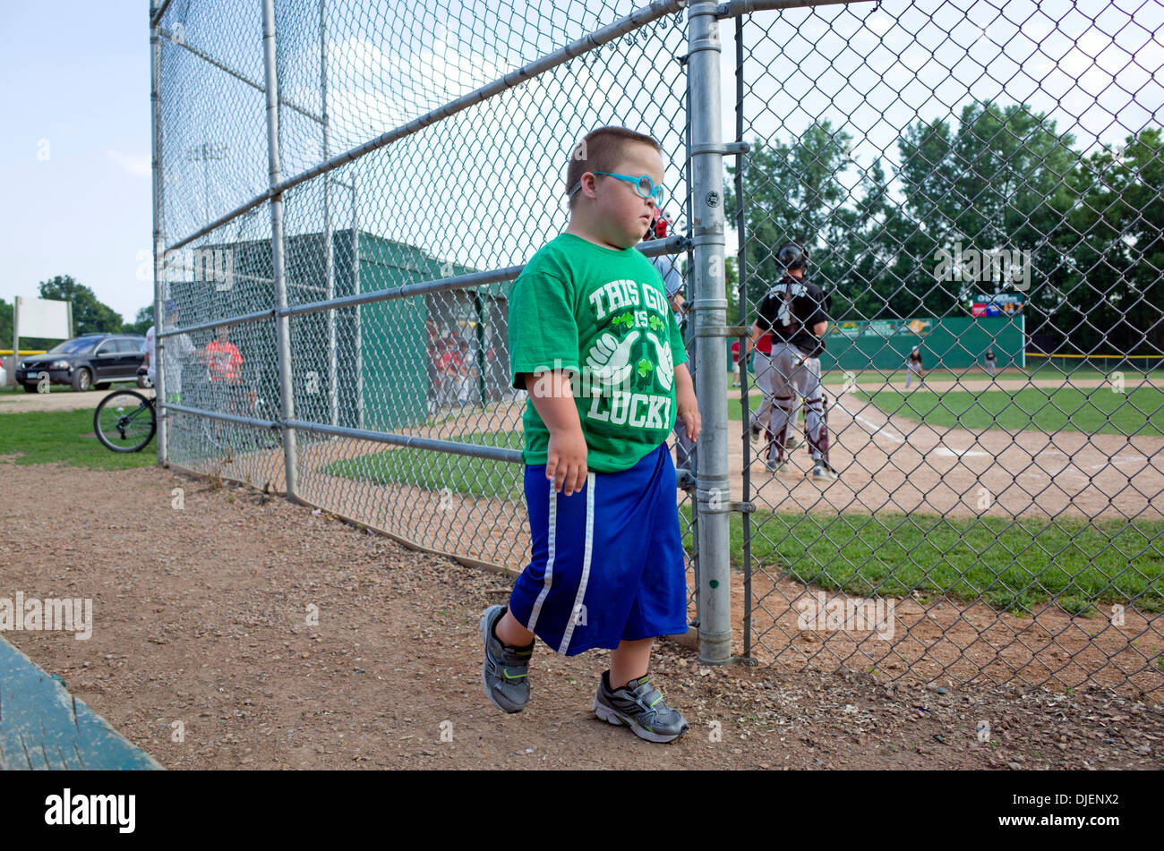 Young Down's Syndrome boy wearing his This Guy is Lucky Irish t-shirt at the ball game. St Paul Minnesota MN USA - Stock Image