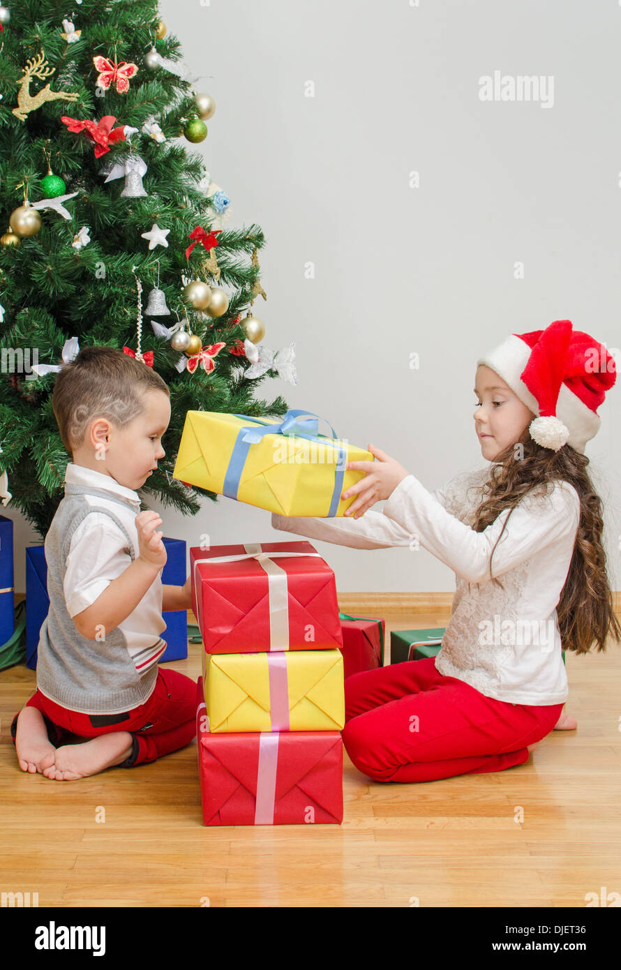Christmas Gifts For Brother.Brother And Sister Packing Christmas Gifts Stock Photo