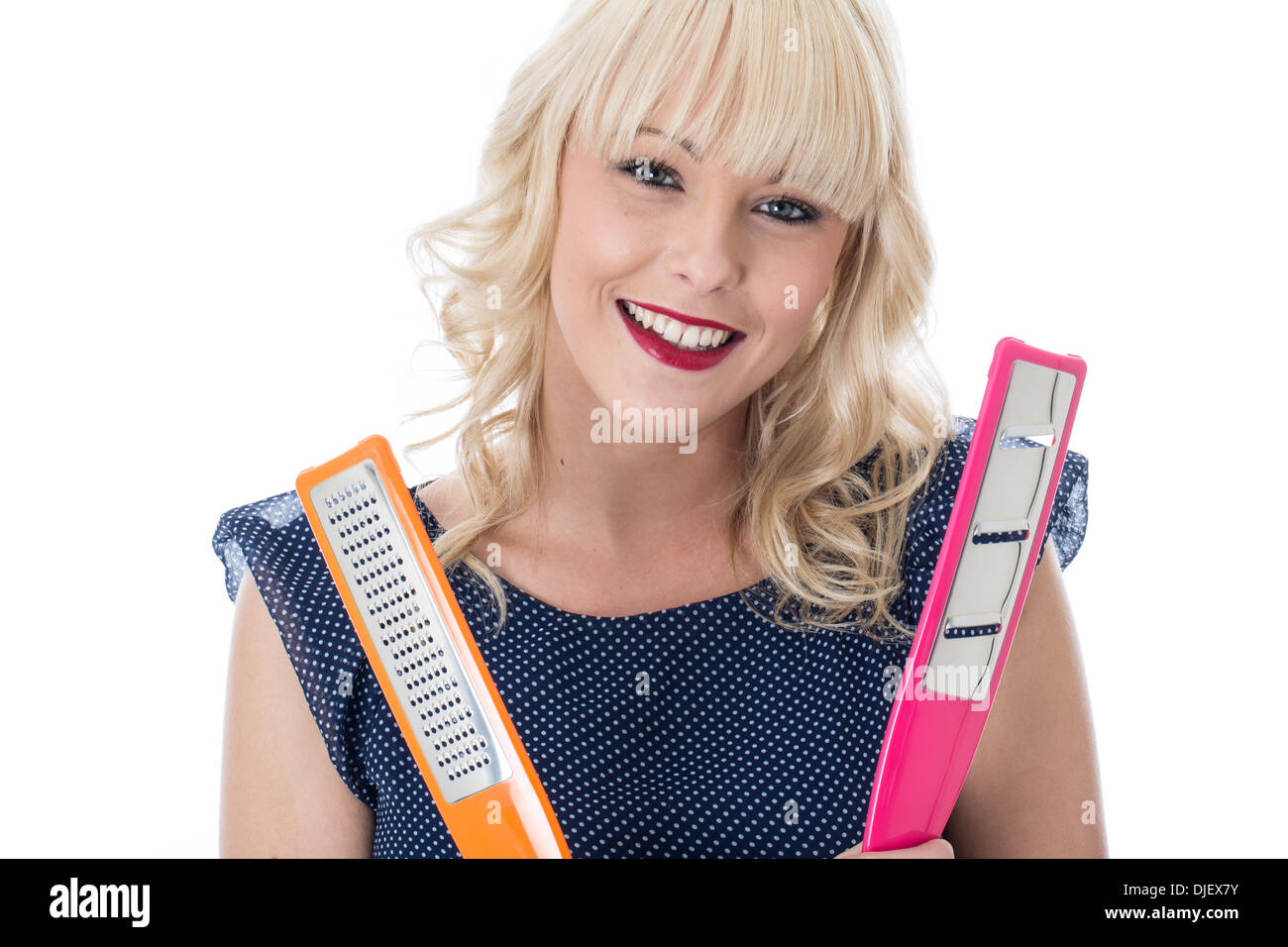 Model Released. Attractive Young Woman Holding Kitchen Utensils Stock Photo