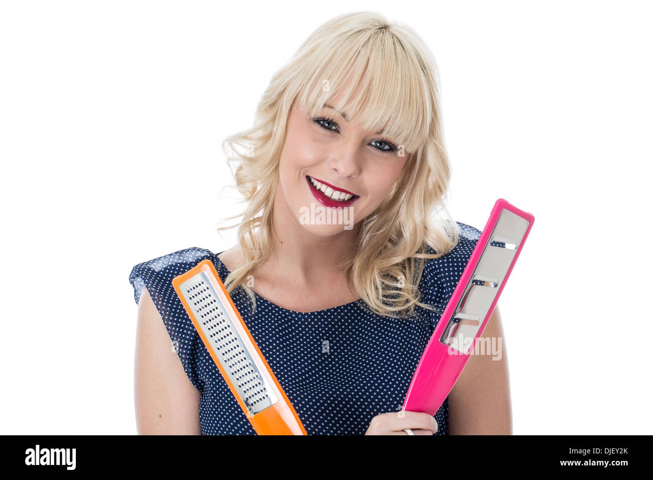 Model Released. Attractive Young Holding Kitchen Utensils - Stock Image