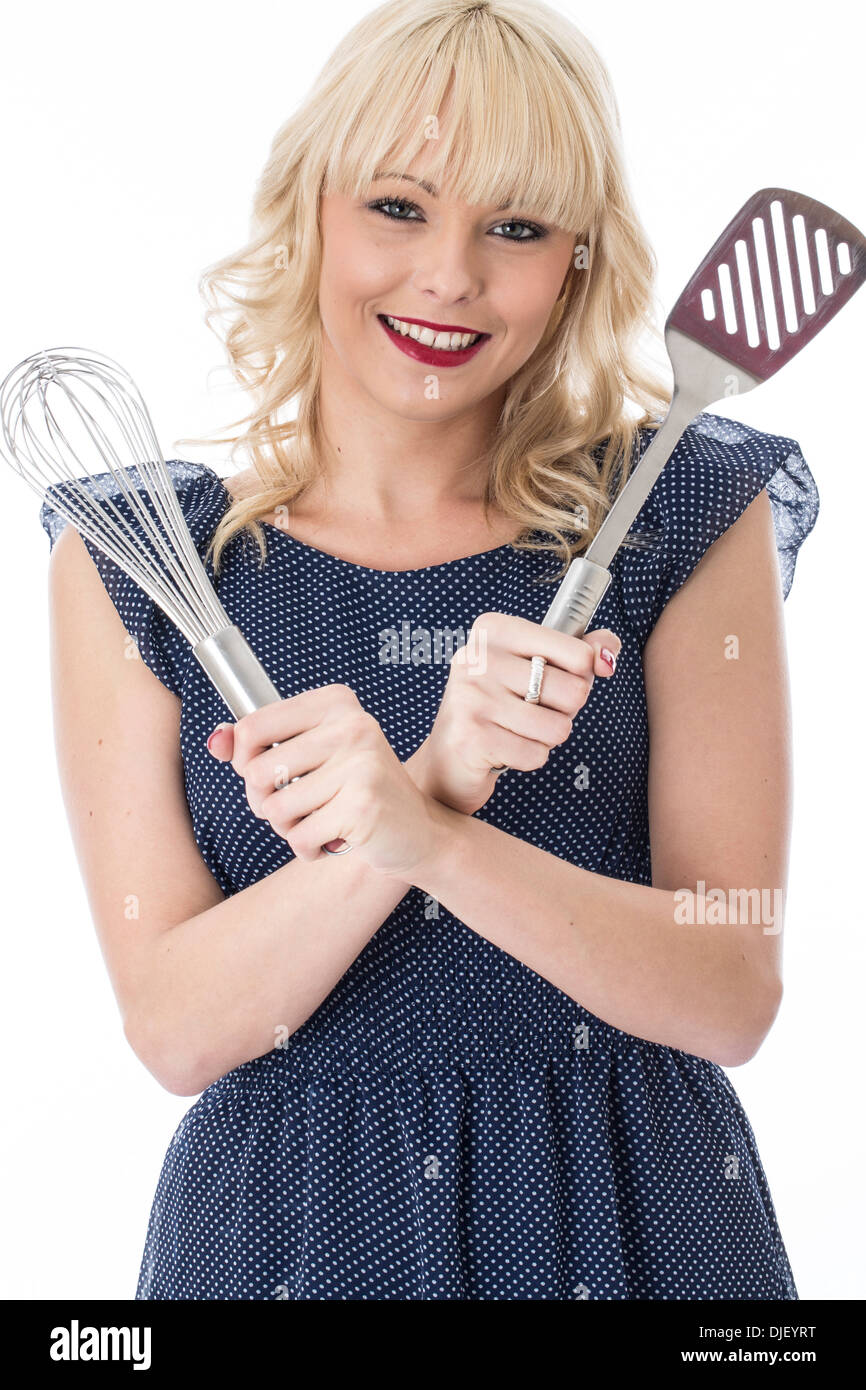 Attractive Young Woman Holding Kitchen Utensils - Stock Image